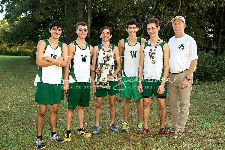 Woodlawn School Varsity Boys Cross Country runners celebrate with their trophy after winning the S.P.A.A. Boys Cross Country Tournament Championship,Thursday afternoon October 16, 2014 at Fisher Farms in Davidson, NC.<br /> <br /> Charlotte Photographer - PatrickSchneiderPhoto.com