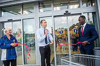 Thursday  21 July 2016<br /> Pictured: Store Manager David Young ( centre )  with (L-R) Louraine Kansella and Area Manager for West Wales, Dayo Layinka  opening the new store. Re: ALDI Haverfordwest Grand Re-opening