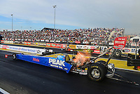 Sept. 28, 2012; Madison, IL, USA: NHRA top fuel dragster driver T.J. Zizzo (near lane) races alongside Terry McMillen during qualifying for the Midwest Nationals at Gateway Motorsports Park. Mandatory Credit: Mark J. Rebilas-