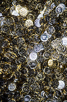 Tuesday 28 February 2017<br /> Pictured: Thousands New One pound coins onside the mint <br /> Re: The Royal Mint in Llantrisant is producing the new one pound coin