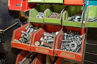 Spare nuts & bolts in a farm workshop