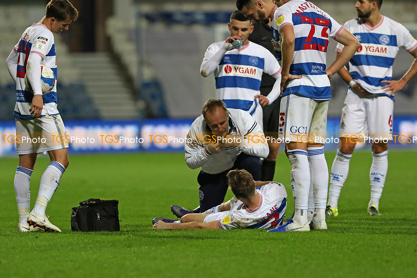 Todd Kane of Queens Park Rangers goes down injured during Queens Park Rangers vs Watford, Sky Bet EFL Championship Football at The Kiyan Prince Foundation Stadium on 21st November 2020