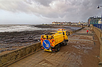 WEATHER PICTURE WALES<br /> Pictured: A council lorry sweeps sand and debris from the promenade in the seaside town of Porthcawl, south Wales, UK. Wednesday 03 January 2018<br /> Re: Storm Eleanor affects parts of the UK.