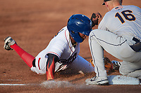Samil Polanco (13) of the Kannapolis Cannon Ballers tries to avoid the tag from Charleston RiverDogs third baseman Curtis Mead (16) at Atrium Health Ballpark on June 29, 2021 in Kannapolis, North Carolina. (Brian Westerholt/Four Seam Images)
