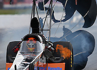 May 17, 2014; Commerce, GA, USA; NHRA top fuel dragster Clay Millican on fire during qualifying for the Southern Nationals at Atlanta Dragway. Mandatory Credit: Mark J. Rebilas-USA TODAY Sports