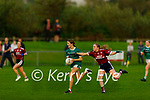 Niamh Broderick of MKL Gaels on a solo run as Scartaglen's Sarah O'Sullivan puts in a tackle in the Kerry Ladies Division 2 county league final