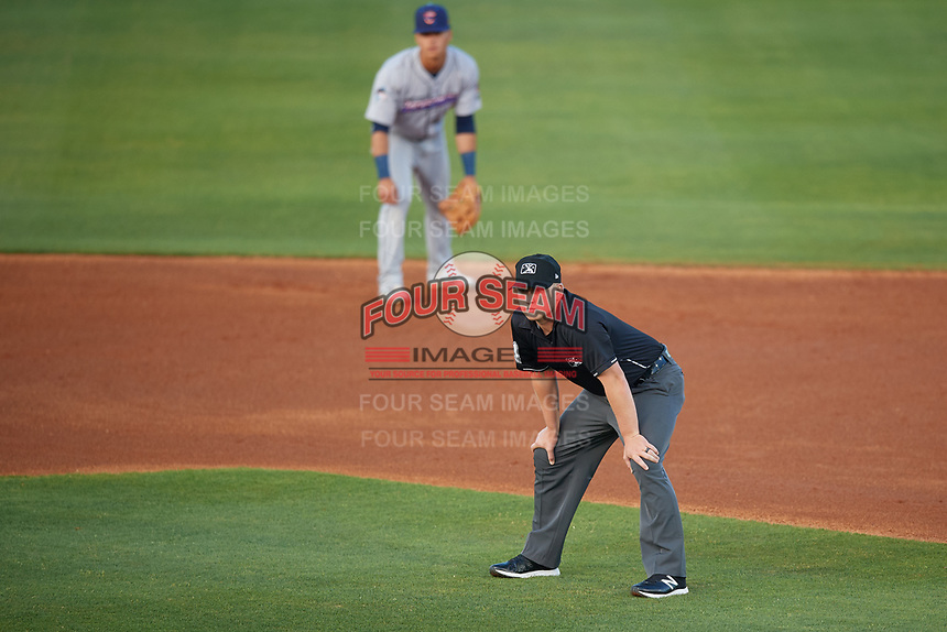 Umpire Matthew Bates and second baseman Bryson Brigman (6) in position during a Southern League game between the Jacksonville Jumbo Shrimp and Mobile BayBears on May 7, 2019 at Hank Aaron Stadium in Mobile, Alabama.  Mobile defeated Jacksonville 2-0.  (Mike Janes/Four Seam Images)