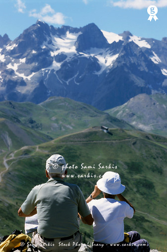 Seniors couple contemplating Barre des Ecrins and La Meije Glaciers from Prorel summit, France, Alps, Serre-Chevalier  (Licence this image exclusively with Getty: http://www.gettyimages.com/detail/81867338 )