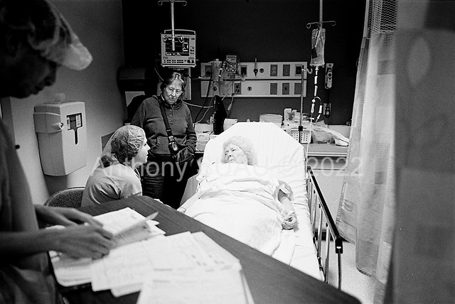 Chicago, Illinois<br /> USA<br /> December 17, 2009<br /> <br /> At the University of Chicago Medical Center Geraldine Martin, 80 years old, is prepared for open heart surgery to have a valve replaced and hole repaired. She is accompanied by her sister Helen Martin prior to the surgery. A nurse gives her some practical advice.