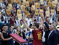 Calcio, Serie A: Roma, stadio Olimpico, 28 maggio 2017.<br /> AS Roma's president James Pallotta lifts the arm of Francesco Totti during a ceremony to celebrate his last match with AS Roma after the Italian Serie A football match between AS Roma and Genoa at Rome's Olympic stadium, May 28, 2017.<br /> Francesco Totti's final match with Roma after a 25-season career with his hometown club.<br /> UPDATE IMAGES PRESS/Isabella Bonotto