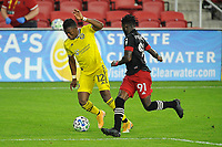 WASHINGTON, DC - OCTOBER 28: Luis Diaz #12 of Columbus Crew SC battles for the ball with Oniel Fisher #91 of D.C. United during a game between Columbus Crew and D.C. United at Audi Field on October 28, 2020 in Washington, DC.