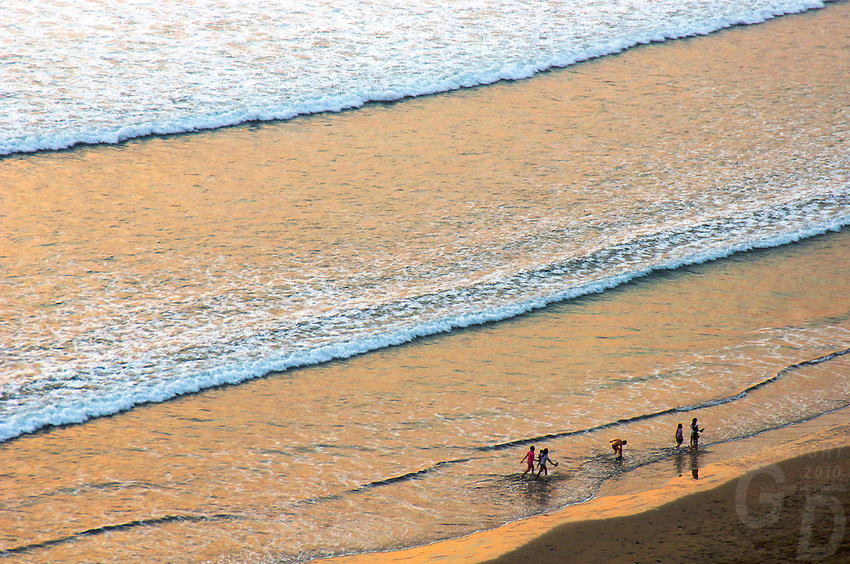 People aerial view at Sunset Kuta Beach, Legian Bali