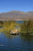 Lake Titicaca, Peru. Reed boat floating off the floating island of Uros.