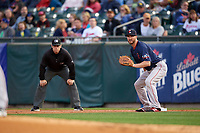 Pawtucket Red Sox first baseman Jantzen Witte (31) holds a runner on as umpire Brian Peterson looks on during a game against the Buffalo Bisons on August 31, 2017 at Coca-Cola Field in Buffalo, New York.  Buffalo defeated Pawtucket 4-2.  (Mike Janes/Four Seam Images)
