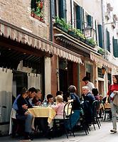 A traditional al fresco family meal outside Trattoria Da Bepi in the Cannareggio district of Venice.