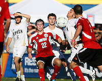 Michael Nanchoff #9 of the University of Akron  chests the ball away from Dylan Mares #22 of the University of Louisville during the 2010 College Cup final at Harder Stadium, on December 12 2010, in Santa Barbara, California.Akron champions, 1-0.