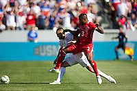 Carson, CA - Sunday, February 8, 2015 Clint Dempsey (8) of the USMNT holds off Harold Cummings (3) of Panama. The USMNT defeated Panama 2-0 during an international friendly at the StubHub Center.