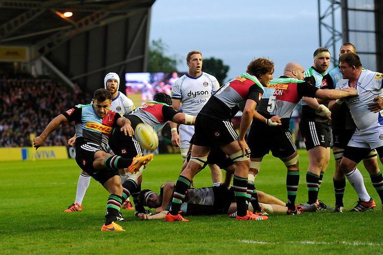 Danny Care of Harlequins sends up a box kick to clear his line