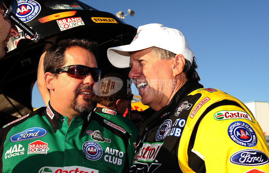 Sept. 23, 2011; Ennis, TX, USA: NHRA funny car driver John Force (right) confers with crew chief Dean Antonelli during qualifying for the Fall Nationals at the Texas Motorplex. Mandatory Credit: Mark J. Rebilas-