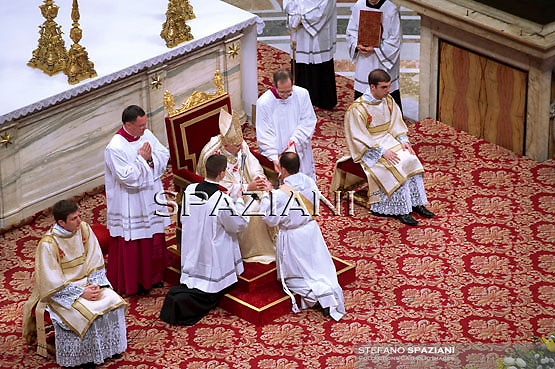 Newly ordained deacons prostate in front of Pope Benedict XVI in St. Peter's basilica in the Vatican on June 20, 2010. The pontiff celebrated a mass for priestly ordination of the deacons of the Roman diocese
