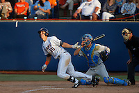 Michael Lorenzen #55 of the Cal State Fullerton Titans bats in front of Shane Zeile #14 of the UCLA Bruins and umpire Mark Chapman during the NCAA Super Regional at Goodwin Field on June 7, 2013 in Fullerton, California. UCLA defeated Cal State Fullerton, 5-3. (Larry Goren/Four Seam Images)