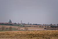 peloton entering the 'Plugstreets' gravel sections<br /> <br /> 81st Gent-Wevelgem in Flanders Fields (1.UWT)<br /> Deinze > Wevelgem (251km)