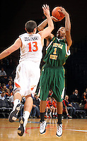 Dec. 20, 2010; Charlottesville, VA, USA; Norfolk State Spartans guard/forward Rob Hampton (1) is defended by Virginia Cavaliers guard Sammy Zeglinski (13) as he shoots the ball during the game at the John Paul Jones Arena. Mandatory Credit: Andrew Shurtleff