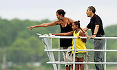 United States President Barack Obama, first lady Michelle Obama and daughter Sasha watch dolphins as they tour St. Andrews Bay on the Bay Point Lady, Sunday, August 15, 2010 In Panama City Beach, Florida. The First Family is visiting the area to help promote tourism and check up on cleanup efforts from the aftermath of the Deepwater Horizon Oil spill. .Credit: Mark Wallheiser - Pool via CNP