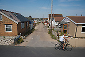 Most roads on the Brooklands Estate in Jaywick Sands, close to the Essex resort of Clacton-on-Sea are unadopted, without street lighting and in serious disrepair.  The estate's small wooden houses - many little bigger than beach huts - were originally built as holiday homes. Brooklands is the most deprived ward in the UK, according to the latest Indices of Multiple Deprivation.