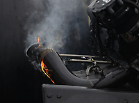 Sep 14, 2019; Mohnton, PA, USA; Detailed view of fire on the headers of NHRA top fuel driver Austin Prock after exploding an engine during qualifying for the Reading Nationals at Maple Grove Raceway. Mandatory Credit: Mark J. Rebilas-USA TODAY Sports