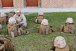 October 22, 2014. Camp LeJeune, North Carolina.<br />  LCpl. Princesse Aldrete, age 23, watches over her platoon's gear after patrol training. Each Marine in the unit takes a turn looking after the gear while the other members of the unit go to the mess hall.<br />  The Ground Combat Element Integrated Task Force is a battalion level unit created in an effort to assess Marines in a series of physical and medical tests to establish baseline standards as the Corps analyze the best way to possibly integrate female Marines into combat arms occupational specialities, such as infantry personnel, for which they were previously not eligible. The unit will be comprised of approx. 650 Marines in total, with about 400 of those being volunteers, both male and female. <br />  Jeremy M. Lange for the Wall Street Journal<br /> COED