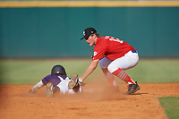 Payton Allen (12) of Bentonville High School in Rogers, AR tags Tommy Tavarez (14) sliding back into second base during the Perfect Game National Showcase at Hoover Metropolitan Stadium on June 20, 2020 in Hoover, Alabama. (Mike Janes/Four Seam Images)