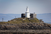 Pictured: Mumbles Lighthouse by Bracelet Bay near Swansea, Wales, UK. Monday 26 April 2021<br /> Re: Lockdown rules caused by the Covid-19 Coronavirus pandemic have been relaxed, with outdoors pubs, restaurants and cafes now open in Wales, UK.