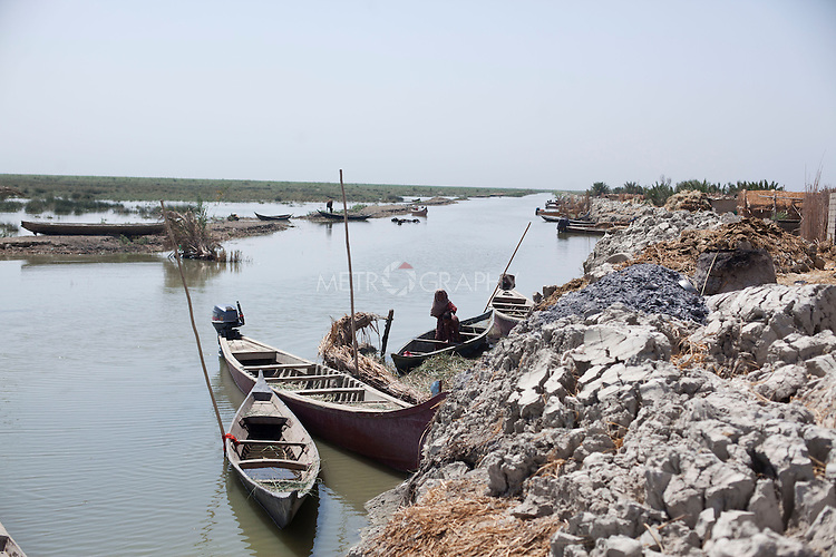 AL-SELKHA, IRAQ: Boats line the waterways around the village of Al Selkha...Dozens of families displaced by years of violence live in the village of Al Selkha in Nasiriya...Photo by Ali Arkady/Metrography
