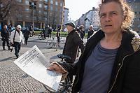 """Etwa 3 dutzend Menschen versuchten am Samstag den 28. Maerz 2020 in Berlin-Mitte, trotz einem allgemeinen Versammlungsverbot durch die Behoerden sich zu einer """"Hygienedemo"""" zu versammeln. Ihre Forderung war """"fuer unsere Verfassung, das Grundgesetz, sowie Transparenz, Pressefreiheit, Wahlen und vollstaendige Demokratie & Transparenz bei der Einsetzung neuer Wirtschaftsgesetze in Form einer """"Verfassung der Oekonomie"""".<br /> Es wurden Exemplare des Grundgesetz verteilt. Die Polizei forderte die Menschen auf sich zu zerstreuen und nach ca. 30 Minuten nahm sie von Menschen, die der Aufforderung nicht nachkamen die Personalien auf und erteilte Platzverweise.<br /> Aufgerufen zu der Aktion hatte eine Gruppe namens """"nichtohneuns.de"""".<br /> Im Bild: Eine Frau mit einem Flugblatt zu der Kundgebung.<br /> 28.3.2020, Berlin<br /> Copyright: Christian-Ditsch.de<br /> [NUR FUER REDAKTIONELLE ZWECKE! Werbung nur auf Anfrage beim Fotografen. Inhaltsveraendernde Manipulation des Fotos nur nach ausdruecklicher Genehmigung des Fotografen. Vereinbarungen ueber Abtretung von Persoenlichkeitsrechten/Model Release der abgebildeten Person/Personen liegen nicht vor. NO MODEL RELEASE! Don't publish without copyright Christian-Ditsch.de, Veroeffentlichung nur mit Fotografennennung, sowie gegen Honorar, MwSt. und Beleg. Konto: I N G - D i B a, IBAN DE58500105175400192269, BIC INGDDEFFXXX, Kontakt: post@christian-ditsch.de<br /> Bei der Bearbeitung der Dateiinformationen darf die Urheberkennzeichnung in den EXIF- und  IPTC-Daten nicht entfernt werden, diese sind in digitalen Medien nach §95c UrhG rechtlich geschuetzt. Der Urhebervermerk wird gemaess §13 UrhG verlangt.]"""