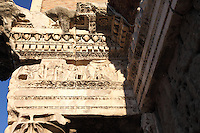 Rome, Fora: A bas relief among the ones that lie on the top of the so-called Colonnacce, the ancient Roman columns  that decorated the surrounding wall of the Forum of the emperor Nerva (I century AD). It was a sunny day and the white marble is enlightened.