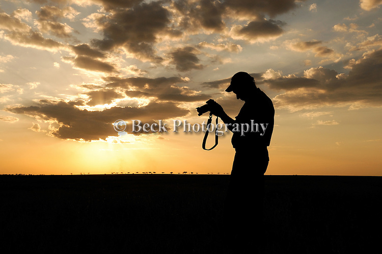 Silhouette of a photographer at sunrise in Africa