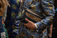Milan,Italy - 19th june 2021 - Dolce & Gabbana fashion show for Milano fashion week Men's collection 18-22 june 2021 - close up man with a handbag
