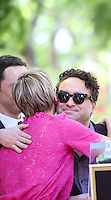 HOLLYWOOD, LOS ANGELES, CA, USA - OCTOBER 29: Kaley Cuoco, Johnny Galecki at the ceremony honoring Kaley Cuoco with a star in the Hollywood Walk Of Fame on October 29, 2014 in Hollywood, Los Angeles, California, United States. (Photo by Xavier Collin/Celebrity Monitor)