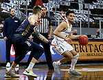 SIOUX FALLS, SD - MARCH 8: Matt Mims #1 of the South Dakota State Jackrabbits looks to drive against Carlos Jurgens #11 of the Oral Roberts Golden Eagles during the Summit League Basketball Tournament at the Sanford Pentagon in Sioux Falls, SD. (Photo by Dave Eggen/Inertia)