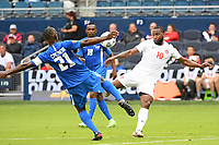 KANSASCITY, KS - JULY 11: Sebastien Cretinoir #21 of Martinique ,  Junior Hoilett #10 of Canada during a game between Canada and Martinique at Children's Mercy Park on July 11, 2021 in KansasCity, Kansas.