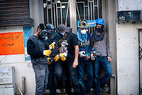 copyright : Magali Corouge /Documentography<br />Taksim square, Istanbul, Turkey, the 11th of June 2013. <br /><br />A group of young protestors hiding from the tear gaz . Police started to evacuate Taksim square, on the early morning of the 11th of June, after more than a week of occupation.