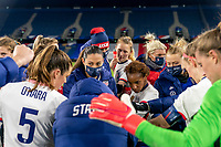 LE HAVRE, FRANCE - APRIL 13: Christen Press #23 of the USWNT huddles with her team after a game between France and USWNT at Stade Oceane on April 13, 2021 in Le Havre, France.