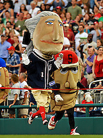 16 May 2012: Geoprge Washington, one of the Washington Nationals Racing Presidents, entertains fans between inning of a game against the Pittsburgh Pirates at Nationals Park in Washington, DC. The Racing Perogies joined the race as well. The Nationals defeated the Pirates 7-4 in the first game of their 2-game series. Mandatory Credit: Ed Wolfstein Photo