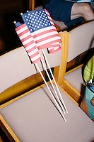 American flags rest on a chair before Texas senator and Republican presidential candidate Ted Cruz speaks at a town hall put on by the Concerned Veterans for American at Milford Town Hall in Milford, New Hampshire.