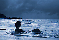 Seaside bather in shallow surf.<br />