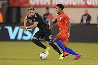 EAST RUTHERFORD, NJ - SEPTEMBER 7: Weston McKennie #8 of the United States battles for the ball with Hector Herrera #16 of Mexico during a game between Mexico and USMNT at MetLife Stadium on September 6, 2019 in East Rutherford, New Jersey.