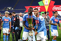 Napoli's Kalidou Koulibaly and Faouzi Ghoulam hold the trophy at the end of the Italian Cup football final match between Napoli and Juventus at Rome's Olympic stadium, with closed doors, June 17, 2020. Napoli won 4-2 at the end of a penalty shootout following a scoreless draw.<br /> UPDATE IMAGES PRESS/Isabella Bonotto