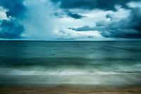 Muted ocean waves caress the beach sand, Cape Cod, Massachusetts, USA.