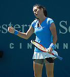 Jamie Hampton (USA) loses to Samantha Stosur (AUS),  6-3, 7-6(3)  at the Western & Southern Open in Mason, OH on August 14, 2013.